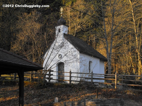 Little forest chapel in the Alps