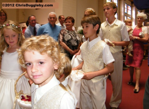 The seven bridesmaids and pageboys escort the Bride to the altar