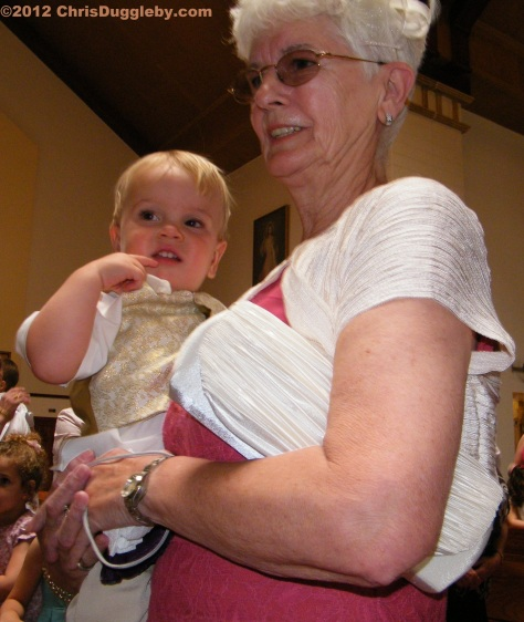 Youngest pageboy Adam gets some support from his English grandmother