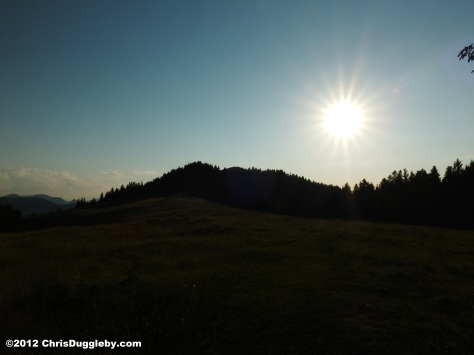 The sun sets over Bavaria's Schwarzenberg mountain and the Voralpenland