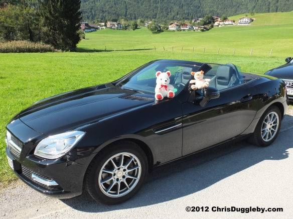 Princess Pink Lips shows how to go topless in style on holiday in her Merc SLK