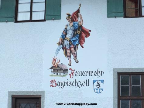 Feuerwehr Bayrischzell: The emblem on the Firestation wall.....serious jobs need serious art