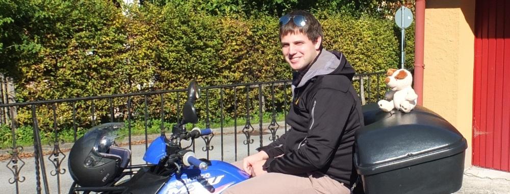 Pascal Duggleby picks up a hitchhiker (RISKKO) on his Quadbike