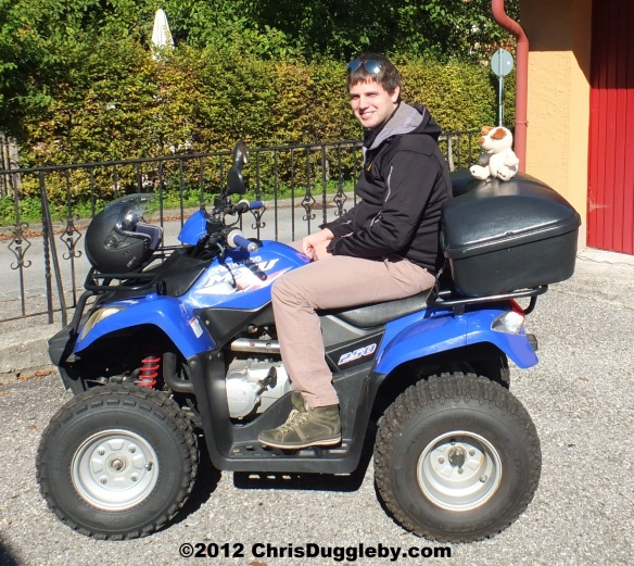 Pascal Duggleby picks up a hitchhiker on his Quadbike