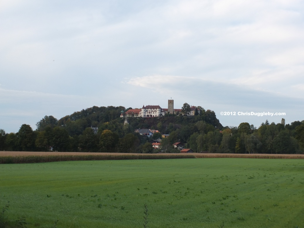 View across the fields of the fairytale castle of Schloss Neubeuern in the Bavarian Alps