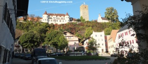 View of the square of Neubeuern market village overlooked by the castle or schloss