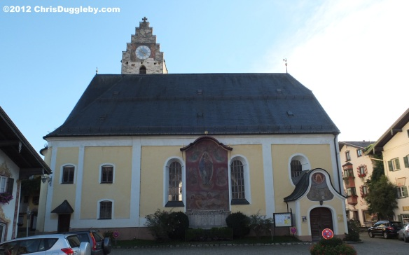 The Neubeuern village church sits at the opposite side of the square to the schloss