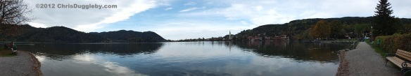 Panoramic View of lake Schliersee from the lakeside path at the edge of the town of Schliersee in Bavaria