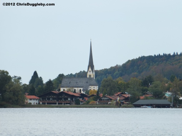 Church on the opposite side of lake Schliersee in Autumn