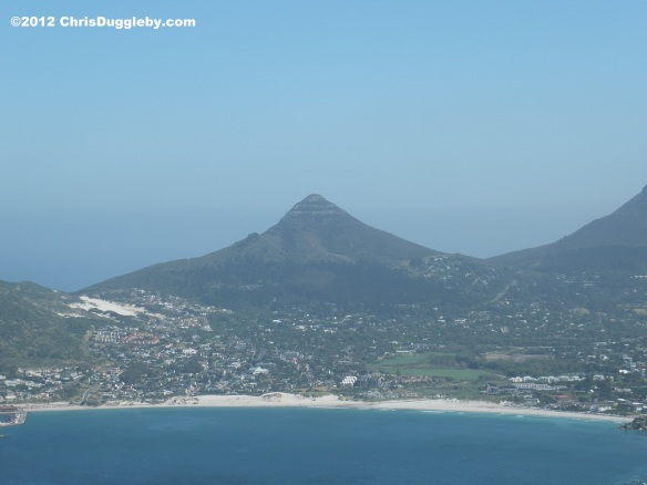 View of Little Lions Head Mountain as seen from Chapmans Peak with Hout Bay in the foreground