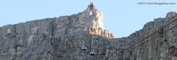 Table Mountain cable cars getting rather close as they overtake on a sunny Cape Town day