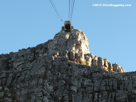 Will they get this big cable car into that little hole at the top of Table Mountain