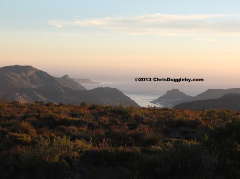 Sunset view of Hout Bay and mountains from the top of table mountain