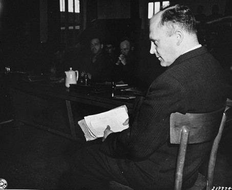 Friedrich Hoffmann (Czech Priest) with records of 324 other inmate priests who died after being infected with malaria during Nazi tests at Dachau (courtesy of Wikipedia)