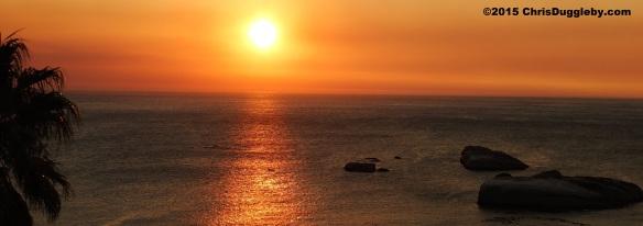 1. Canoeist paddling past Sunset Rocks (Llandudno, Cape Town) at Sunset