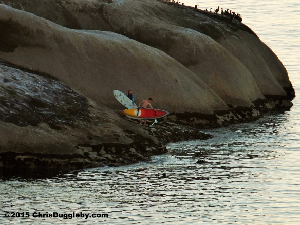 1. Teenagers arriving at Sunset Rocks on their surf boards
