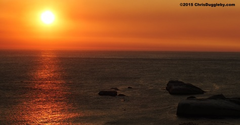6 Canoeist paddling past Sunset Rocks (Llandudno, CapeTown) at Sunset