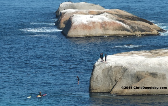 Cape Town 'Paddle' Boy in Wetsuit jumping off Sunset Rocks
