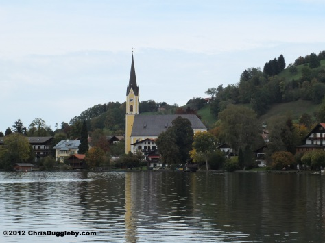 View of Schliersee church over lake Schliersee in Autumn (when it gets too cold for the parasites)
