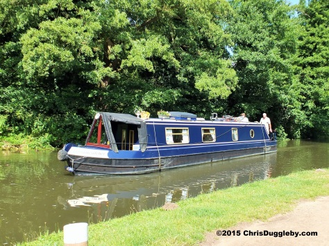 Canal Boat in action on the river Wey Navigation Waterway
