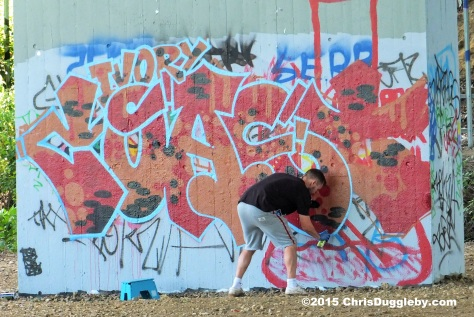 Street Artist at work, presumably for the local council, renovating the M25 near Woking