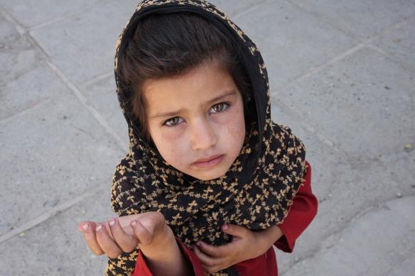 Afghan girl begging