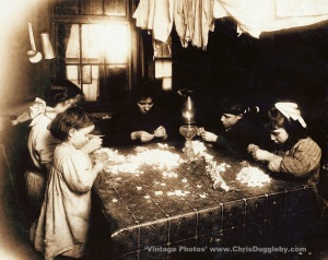 The Mortaria children (youngest only 3 yrs of age) making flower wreaths in New York, USA (1912)