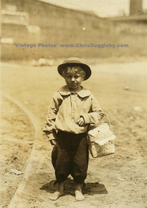 Young 'Support' Worker known as a Dinner Toter (much cheaper than older relatives) on his way to the Eagle and Pheonix Mill, Columbus, Georgia, USA (1913)