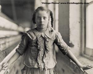 This girl is a Spinner running 4 looms at Whitnel Cotton Mfg. Co., Whitnel, North Carolina, USA (1908)