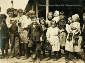 All these children are Oyster Shuckers (except the babies) at Dukate Co., Pass Christian, Mississippi, USA (1911)