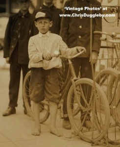 10 yr old boy at Danville Messengers - wearing company issued company footwear 1911