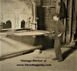The Lehr Glass Factory in Grafton, W. Va. - 'Carrying in Boy'