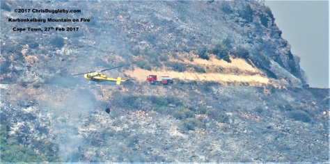 Cape Towns Land and Airborn fire fighting crews join at Karbonkelberg to start fighting the bush fires
