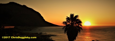 A 'normal' sunset from Sunset Rocks at Llandudno, near Cape Town - just as the sun hits the ocean